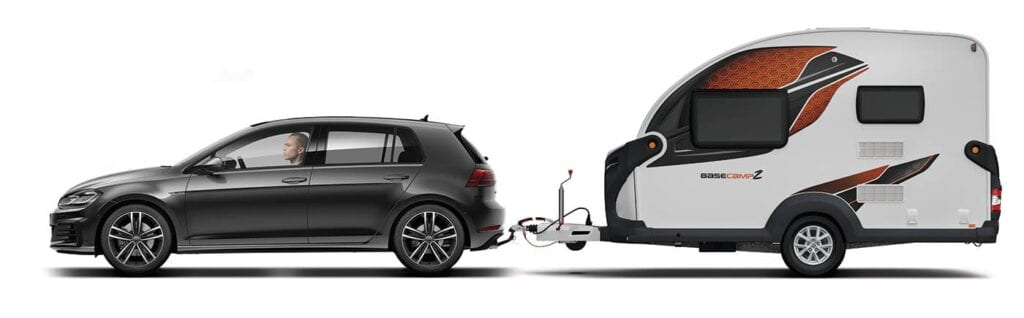 2021 Swift Basecamp CCV: Image of a Swift Basecamp Caravan being towed by a small black car.