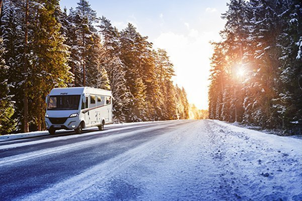 Why Choose a Pilote Motorhome: Image of a Pilote Motorhome driving in the snow.