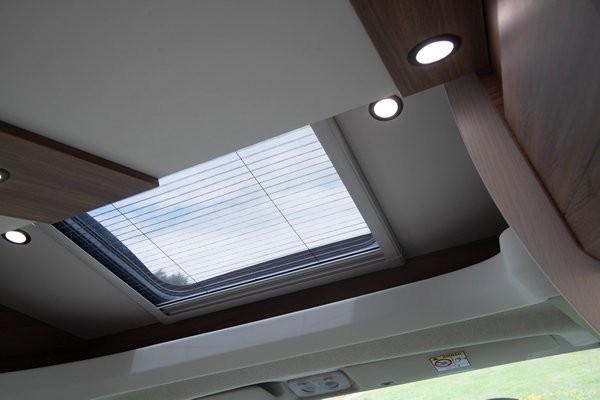 Why Choose a Pilote Motorhome: Image of  the skylight and heating vents in a Pilote Motorhome at sunset.