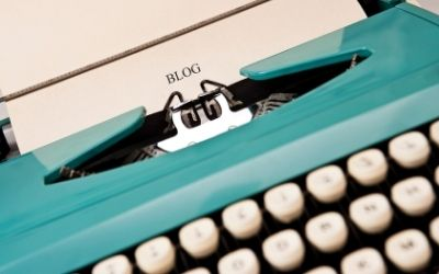 Help & Advice: Image of a turquoise coloured typewriter with a sheet of paper, reading 'Blog'.